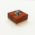 Montessori bolt block with a more challenging acorn nut for threading.