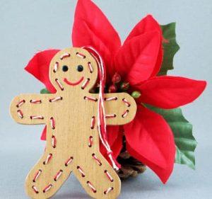 Handmade wooden gingerbread man ornament.