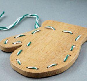 Handmade wooden gingerbread mitten ornament.