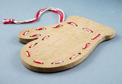 Handmade wooden gingerbread mitten.
