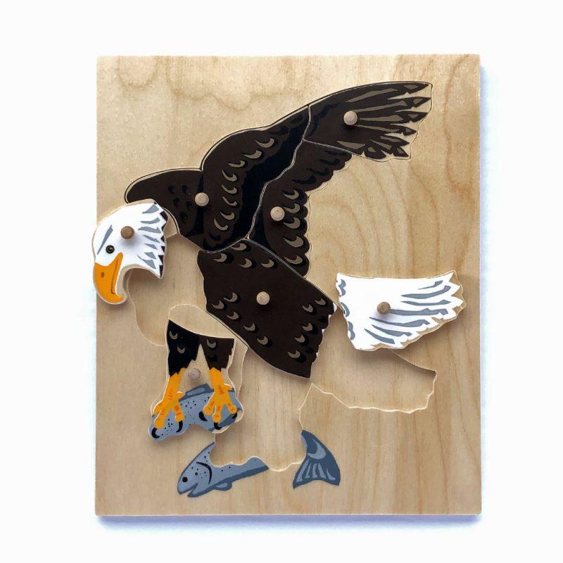 Wooden Bald Eagle puzzle pieces.