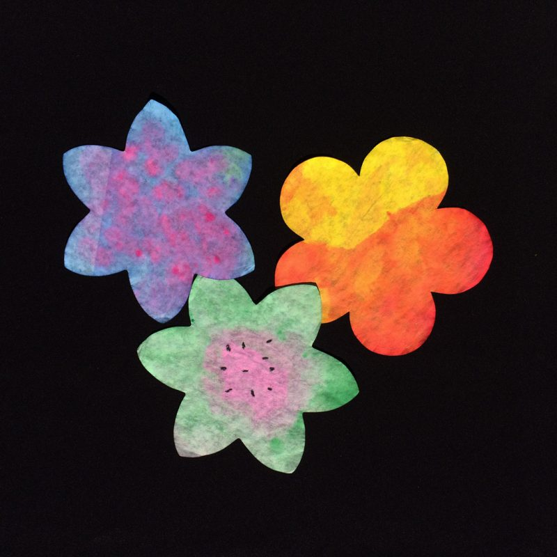 Roylco diffusing paper flowers decorated with food color and watercolors.