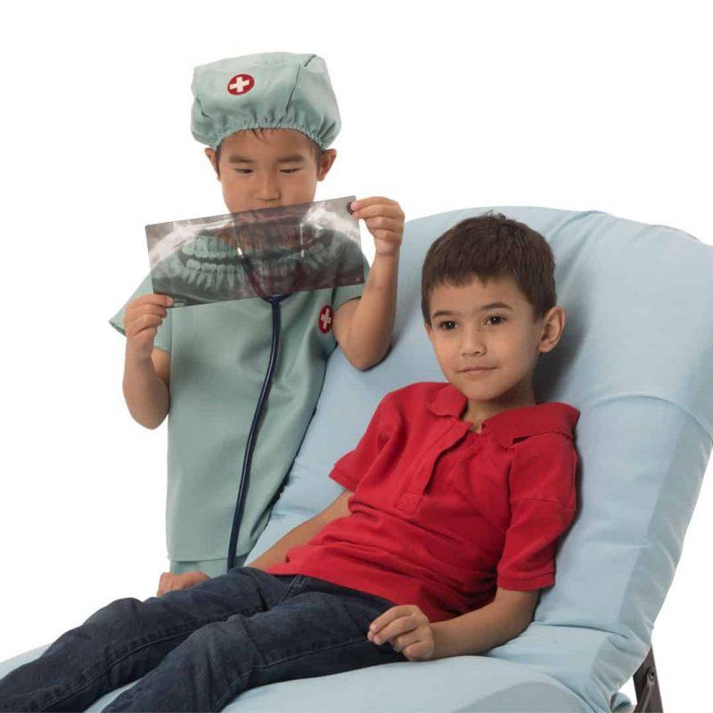 Boys playing dentist with Roylco dental xrays.