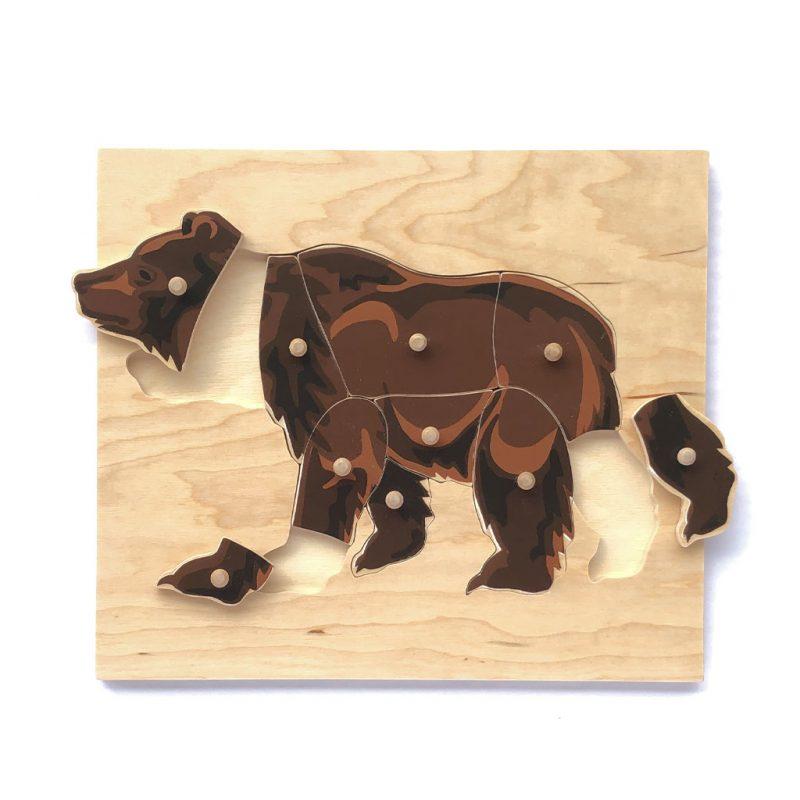 Wooden bear puzzle parts.
