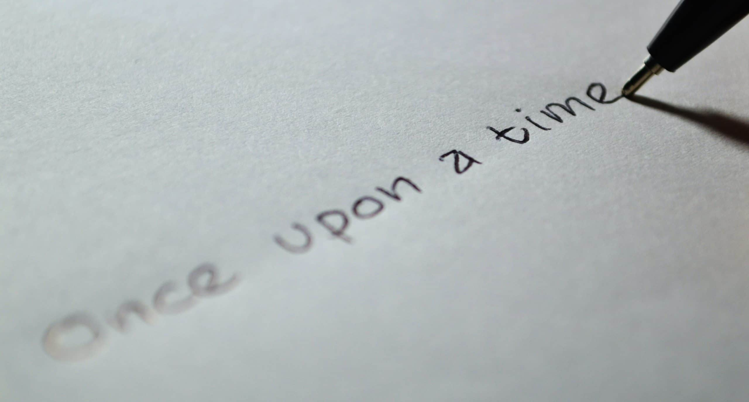 """Piece of paper with """"once upon a time"""" written on it."""