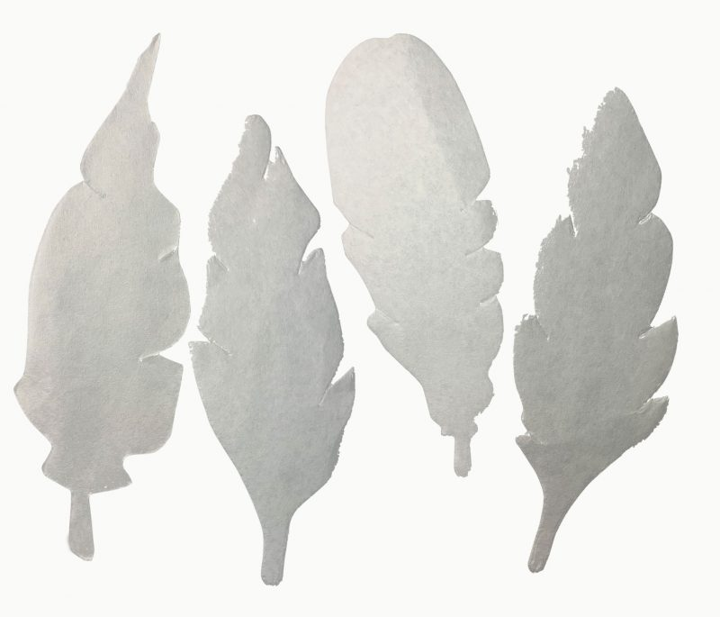 Color diffusing paper feather shapes.