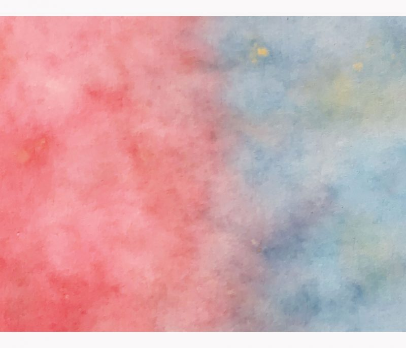 Color diffusing paper sheets in pastel colours.